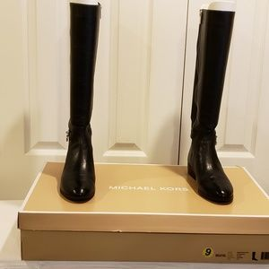 MK black leather and synthetic boots
